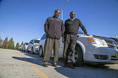 Taxi drivers waiting to pickup passengers, St Louis airport, Missouri. They belong to the Taxi Alliance. Joshua Osho (r) is a driver from Nigeria, and the head of the association Mohamed Hussain (l) i... - David Bacon - 13-11-2015