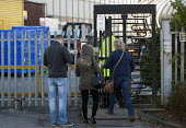 Workers entering a security gate turnstile at start of the shift, Greencore Group, Kiveton Park, Yorkshire - John Harris - 2010s,2015,capitalism,card,cards,clocking on,EBF Economy,employee,employees,Employment,FACTORIES,factory,Food Processing Industry,gate,gates,id,identity,Identity Card,Industries,INDUSTRY,job,jobs,LBR,