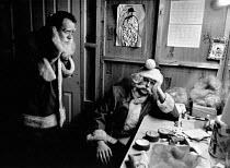 Tired Santas as they change shifts, Selfridges, London - John Sturrock - 01-12-1992