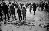 Bloody Sunday, Derry 1972. Flowers and Civil Rights Association banner laid in a pool of blood where one of the Derry 13 was shot dead by paratroopers during a civil rights march. - Martin Mayer - 31-01-1972