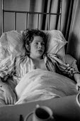 Bloody Sunday, Derry 1972. Sixteen year old Peter Robson, one of those injured when British Paratroopers opened fire on a Civil Rights March in Londonderry, lying in hospital. - Martin Mayer - Irish,1970s,1972,adolescence,adolescent,adolescents,Armed Forces,army,bed,beds,Bloody,Bloody Sunday,British Army,British troops,Catholic,Catholics,child,CHILDHOOD,children,Civil Rights,conflict,Confli