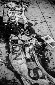 Bloody Sunday, Derry 1972, Civil Rights Association banner and a bunch of flowers laid on a pool of blood from one of the 'Derry 13' shot dead by British paratroopers during a civil rights march - Martin Mayer - 01-02-1972