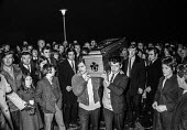 Bloody Sunday, Derry 1972. Mourners carry the coffin of one of the 'Derry 13' shot dead by British paratroopers into the church for the wake. - Martin Mayer - Irish,1970s,1972,a,Armed Forces,army,Bloody,Bloody Sunday,British Army,casket,Catholic,Catholics,child,CHILDHOOD,children,church,churches,Civil Rights,coffin,coffin bearing,communities,community,confl