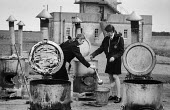 Ireland 1971, young women preparing soup Refugee camp at Gormanston Camp airfield. Refugee Centre for Catholics from Belfast after sectarian violence following the imposition of internment without tri... - Martin Mayer - 16-08-1971