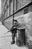 Northern Ireland, British soldier patrolling the streets, Derry, 1971after the imposition of internment without trial - Martin Mayer - 13-08-1971
