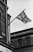 Northern Ireland, Union Jack flag flying, Shankhill Road in Protestant and Unionist Belfast 1971 after the imposition of internment without trial - Martin Mayer - 1970s,1971,Belfast,cities,city,conflict,Conflicts,flag,flags,flying,highway,internment,Ireland,Irish,nationalism,nationalist,nationalists,Northern Ireland,Protestant,Protestants,Road,ROADS,scene,scene