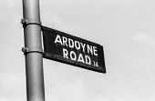 Northern Ireland. Ardoyne Road sign, Belfast , Center of the Catholic community and stronghold of the IRA - Martin Mayer - 1960s,1969,Ardoyne Road,Belfast,Catholic,cities,City,communicating,communication,conflict,Conflicts,highway,IRA,Northern Ireland,road,roads,scene,scenes,sign,signs,street,streets,The Troubles,UCW,Unre