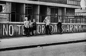 Boys pose in front of Anti British troops graffiti slogan No Tea for Dads Army, Belfast 1971 - Martin Mayer - 21-08-1971
