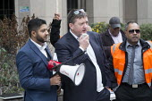 James Farrar GMB London Uber drivers protest at increased commission rates and price cuts outside Uber London HQ. - Philip Wolmuth - 12-11-2015