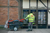 A street cleaner looking at high house prices, Stratford upon Avon, Warwickshire - John Harris - 2010s,2015,agent,agents,avon,Biffa,buy,buyer,buyers,buying,cart,carts,cleaner,cleaners,CLEANING,cleansing,commodities,commodity,cost of living,EARNINGS,EBF,Economic,Economy,employee,employees,Employme
