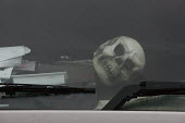 Skull on the dashboard. Drivers in their cabs, Lorry park, M1 Motorway Services, Nottinghamshire - John Harris - 04-12-2015