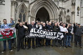Blacklisted construction workers campaigning for justice and compensation. Royal Courts of Justice. London. - Jess Hurd - 2010s,2015,activist,activists,at,banner,banners,blacklist,blacklisted,blacklisting,CAMPAIGN,campaigner,campaigners,campaigning,CAMPAIGNS,Dave Smith,Day of Action,DEMONSTRATING,demonstration,DEMONSTRAT