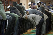 Evening prayers at Birmingham Central Mosque, West Midlands. - Jess Hurd - &,2010s,2015,BAME,BAMEs,Belief,Birmingham,Birmingham Central Mosque,Black,BME,bmes,Christmas,conviction,devotion,diversity,ethnic,ethnicity,Evening,faith,GOD,islam,islamic,LIFE,male,man,men,minorities