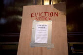 Activists board up the doors of the Policy Exchange with an Eviction Notice in Housing Bill protest. Westminster, London - Jess Hurd - 05-01-2016