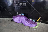 Homeless sleeping rough in front of luxury New Homes construction site hoarding as the Housing Bill is read in Parliament. Westminster. London. - Jess Hurd - 05-01-2016