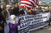 Michigan, USA Muslims rally to condemn ISIS and terrorism, Hamtramck City Hall. The rally was attended by immigrants from Bangladesh and Yemen - Jim West - American,2010s,2015,activist,activists,against,America,American,americans,Asian,Asians,BAME,BAMEs,Bangladeshi,Bangladeshis,banner,banners,Black,BME,bmes,CAMPAIGN,campaigner,campaigners,CAMPAIGNING,CAM