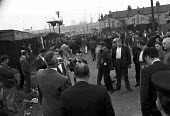 Dockers walk away from TGWU officials, mass meeting, Victoria and Albert Dock, East London August 1965 - NLA - 18-08-1965