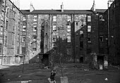 The Gorbals, Glasgow Scotland 1965 - NLA - 1960s,1965,boy,boys,child,CHILDHOOD,children,EQUALITY,excluded,exclusion,flat,flats,Glasgow,Gorbals,HARDSHIP,Housing,Housing Estate,impoverished,impoverishment,INEQUALITY,juvenile,juveniles,kid,kids,m