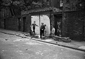 The Gorbals, Glasgow Scotland 1965. - NLA - 1960s,1965,BAME,BAMEs,black,BME,bmes,boy,boys,child,CHILDHOOD,children,cultural,diversity,EQUALITY,ethnic,ethnicity,excluded,exclusion,flat,flats,Glasgow,Gorbals,HARDSHIP,Housing,Housing Estate,impove