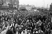 Docks strike 1967. Dockers voting at a mass meeting outside Royal Docks London - NLA - 19-10-1967