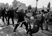 Poll Tax riot Trafalgar Square London 1990 Police charge protest - Paul Mattsson - 1990,1990s,activist,activists,adult,adults,attack,attacking,CAMPAIGN,campaigner,campaigners,CAMPAIGNING,CAMPAIGNS,CLJ,conflict,Conflicts,DEMONSTRATING,Demonstration,DEMONSTRATIONS,force,hit,hitting,Lo