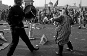 Poll Tax riot Trafalgar Square London 1990 Police charge protest - Paul Mattsson - 1990,1990s,activist,activists,adult,adults,attack,attacking,CAMPAIGN,campaigner,campaigners,CAMPAIGNING,CAMPAIGNS,CLJ,conflict,Conflicts,DEMONSTRATING,Demonstration,DEMONSTRATIONS,FEMALE,force,hit,hit