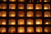 On the Day of the Dead, Oaxacans light candles in the grave wall niches in the citys main cemetery. - David Bacon - &,2000s,2008,ace culture,All Saints' Day,All Souls' Day,altar altars,americas,Amerindian,Amerindians,Belief,burial chamber,candle,candle candles,candles,Catholic,Catholic catholicism,Catholicism,CELEB