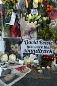 David Bowie Memorial Wall, Brixton, London - Janina Struk - 2010s,2016,ACE,Arts,Bowie,cities,city,Culture,David Bowie,dead,death,deaths,died,floral tribute,floral tributes,flower,flowering,flowers,London,melody,memorial,memories,memory,message,messages,mortali