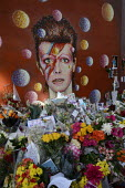 David Bowie Memorial Wall, Brixton, London - Janina Struk - 2010s,2016,ACE,Arts,cities,city,COMMEMORATE,COMMEMORATING,commemoration,COMMEMORATIONS,condolence,condolences,Culture,David Bowie,dead,death,deaths,died,floral tribute,floral tributes,flower,flowering