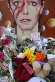 David Bowie Memorial Wall, Brixton, London - Janina Struk - 2010s,2016,ACE,Arts,Bowie,cities,city,COMMEMORATE,COMMEMORATING,commemoration,COMMEMORATIONS,condolences,Culture,David Bowie,dead,death,deaths,died,floral tribute,floral tributes,flower,flowering,flow
