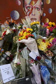 David Bowie Memorial Wall, Brixton, London - Janina Struk - 2010s,2016,ACE,Arts,Bowie,cities,city,commemorate,COMMEMORATING,commemoration,COMMEMORATIONS,condolence,condolences,Culture,David Bowie,dead,death,deaths,died,floral tribute,floral tributes,flower,flo