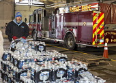 Flint, Michigan, clean Bottled water is delivered to Fire Station #6 for residents to collect. Water and water filters were distributed after cost-cutting by state officials led to high lead levels in... - Jim West - American,2010s,2016,agencies,agency,aid,Aid Agency,aid workers,America,American,americans,assisting,Austerity Cuts,bottle,bottled,bottled water,bottles,charities,charity,clean,clean water,contaminated