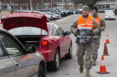 Flint, Michigan National Guard distributing bottled water to residents at Fire Station #1. Bottled water and water filters are being distributed after cost-cutting by state officials led to high lead... - Jim West - 19-01-2016
