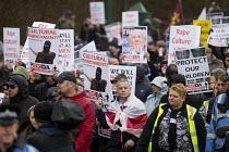 Tommy Robinson leads a Pegida march to a remote business park near Birmingham International Rail Station. West Midlands. - Jess Hurd - 06-02-2016