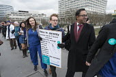 Junior doctors strike over a proposed new contract cross Westminster Bridge to protest outside the Houses of Parliament. - Philip Wolmuth - 2010s,2016,activist,activists,against,Asian,Asians,BAME,BAMEs,black,BMA,BME,bmes,Bridge,CAMPAIGN,campaigner,campaigners,CAMPAIGNING,CAMPAIGNS,cultural,DEMONSTRATING,demonstration,DEMONSTRATIONS,disput