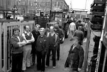 Striking workers occupy Massey Ferguson Banner Lane factory Coventry 1977 - John Harris - 1970s,1977,AEEU,Banner,BANNERS,cities,City,Coventry,disputes,FACTORIES,factory,gate,gates,INDUSTRIAL DISPUTE,job loss,Job Losses,jobs,loss,losses,male,man,member,member members,members,men,Occupation,