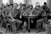 Miners at a pit canteen union meeting Dinnington Colliery Yorkshire 1983 discussing a national ballot for strike action over closure of Lewis Merthyr pit - John Harris - 1980s,1983,canteen,CANTEENS,capitalism,capitalist,close,CLOSED,closing,closing down,closure,closures,Coal Industry,Coal Mine,coalindustry,collieries,colliery,communicating,communication,conversation,c