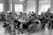 Miners at a pit canteen union meeting Dinnington Colliery Yorkshire 1983 discussing a national ballot for strike action over closure of Lewis Merthyr pit. John Cunningham (r) - John Harris - 1980s,1983,ballot,BALLOTING,ballots,canteen,CANTEENS,capitalism,capitalist,close,CLOSED,closing,closing down,closure,closures,Coal Industry,Coal Mine,coalindustry,collieries,colliery,communicating,com