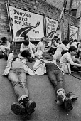 Peoples March for Jobs taking a break with tired feet, West Midlands 1983 - John Harris - 1980s,1983,activist,activists,against,banner,banners,break,CAMPAIGN,campaigner,campaigners,CAMPAIGNING,CAMPAIGNS,DEMONSTRATING,Demonstration,DEMONSTRATIONS,EXHAUSTED,EXHAUSTION,FEMALE,For,jobless,Jobs