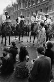 Protesters sit in the road infront of Mounted police, Poll Tax protest riot Trafalgar Square London 1990 - John Harris - 1990,1990s,activist,activists,adult,adults,against,animal,animals,anti,CAMPAIGN,campaigner,campaigners,CAMPAIGNING,CAMPAIGNS,cities,City,CLJ,conflict,Conflicts,DEMONSTRATING,Demonstration,DEMONSTRATIO