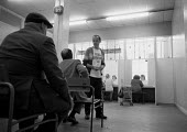 Unemployed waiting at a DHSS benefit office Coventry as the recession intensifies 1982 - John Harris - 24-12-1986
