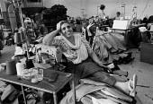 Working in a Leicester sweatshop producing textiles, 1993 The workers have low pay and poor conditions - John Harris - 21-04-1993