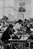 Asian women working in a Leicester sweatshop producing textiles, 1993. The workers have low pay and poor conditions - John Harris - 21-04-1993