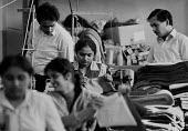 Managers and Asian women working in a Leicester sweatshop producing textiles, 1993. The workers have low pay and poor conditions - John Harris - 1990s,1993,apparel,Asian,Asians,BAME,BAMEs,Black,BME,bmes,boss,bosses,capitalism,check,checking,clothes,clothing,diversity,EARNINGS,EBF,Economic,Economy,employee,employees,Employment,ethnic,ethnicity,