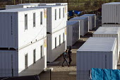 Official refugee camp of shipping containers. Calais, France. - Jess Hurd - 2010s,2016,accommodation,aid,assistance,BME black,boat,boats,Calais,camp,camps,container,containers,Diaspora,displaced,ethnic,ETHNICITY,eu,Europe,european,europeans,europeregi,eurozone,foreign,foreign