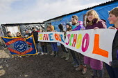 Teachers from the UK volunteer to teach refugees over half term campaign to Save Our School, The Jungle camp, Calais, France. Birmingham NUT and banner - Jess Hurd - 19-02-2016