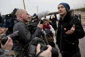 Jason Parkinson interviews actor Jude Law campaigning for child refugees in the makeshift Jungle refugee camp, Calais, France. - Jess Hurd - 21-02-2016