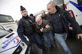 Calais, France, Police arresting Williy Destiert, French far right protest march against immigrants is stopped by the police prior to eviction of refugees in the makeshift Jungle camp by French author... - Jess Hurd - 2010s,2016,activist,activists,adult,adults,against,arrest,arrested,arresting,authorities,Calais,camp,CAMPAIGN,campaigner,campaigners,CAMPAIGNING,CAMPAIGNS,camps,CLJ,CRS,DEMONSTRATING,demonstration,DEM