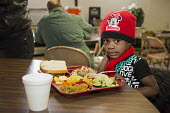 Flint, Michigan, young girl eating, North End Soup Kitchen. The soup kitchen is operated by Catholic Charities - Jim West - 18-02-2016