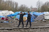 French police forbid photography, Grande-Synthe refugee camp Dunkirk, France. - Jess Hurd - 21-02-2016